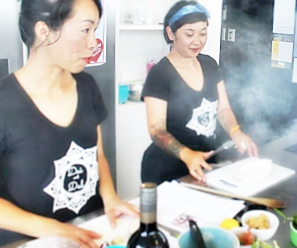 Dai and Dal demonstrate how to make their famous Pork Larb (photo courtesy of https://www.facebook.com/SocialCooking.co.nz